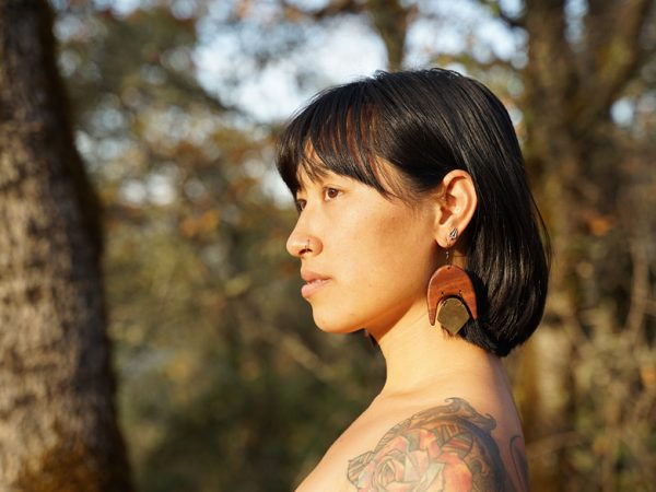 Native and raw, this wooden earring from the California collection of TatianaAshna entitled 'Umbra'